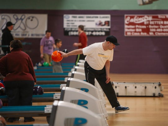 Ron Plewa, 46, of Shelby Township throws the ball down