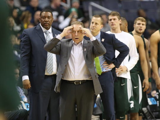 Michigan State basketball coach Tom Izzo reacts on