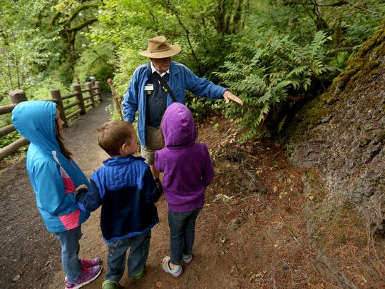 Earl McCollum leads a guided hike for siblings, from left, Karen Parent, 9, Elisha Parent, 5, and Elsie Parent, 5, of Albany, during the 7th annual Historic Silver Falls Day at Silver Falls State Park on Saturday, July 9, 2016.