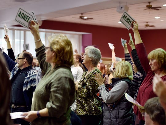 Constituents give a standing ovation in response to