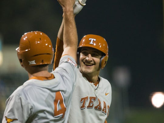 University of Texas catcher Michael Cantu high-fives Tate Shaw after hitting a home run during the sixth inning against Texas A&M-Corpus Christi Tuesday night at Whataburger Field.