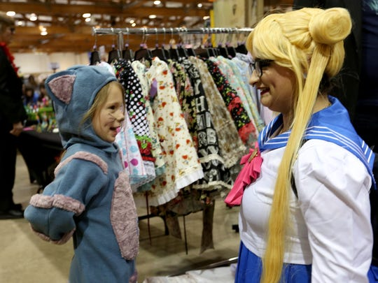 Koa Barrett, 5, of Keizer, dressed as the Cheshire Cat, talks with her favorite character, Sailor Moon, cosplayed by Brooke Walker, 28, of Salem, at the 4th annual Cherry City Comic Con at the Oregon State Fairgrounds in Salem on Saturday, April 9, 2017.