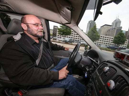 Mark Caplinger, a driver for AAA Hoosier Cab, drives