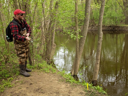 Tab Wakley, of Lansing, fishes on his lunch hour along