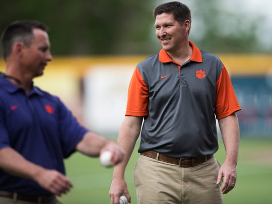 Clemson head basketball coach Brad Brownell and head baseball coach Monte Lee walk off the field after throwing the opening pitch with head football coach Dabo Swinney during the Prowl & Growl at Fluor Field on Wednesday, May 3, 2017.