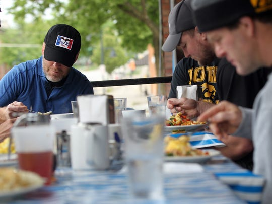 Iowa head coach Tom Brands enjoys a meal with his coaching staff at Bluebird Diner on Tuesday, May 23, 2017.
