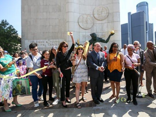 Detroit Mayor Mike Duggan, center, cuts the ribbon
