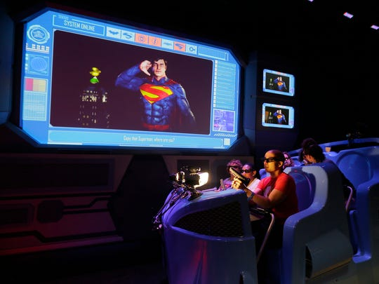 APP Fan Theory's Felecia Wellington Radel and Alex Biese ride the new Justice League: Battle for Metropolis ride during the press preview of the ride at Six Flags Great Adventure in Jackson in Jackson, NJ Thursday, June 15, 2017.