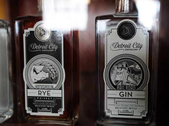 Homegrown Rye whiskey and Railroad Gin are in an antique showcase at Detroit City Distillery in Detroit on Wednesday, June 28, 2017.