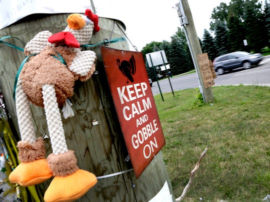 A makeshift memorial was set up on a utility pole at