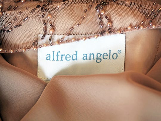 One of 60 remaining Alfred Angelo bridesmaid dresses