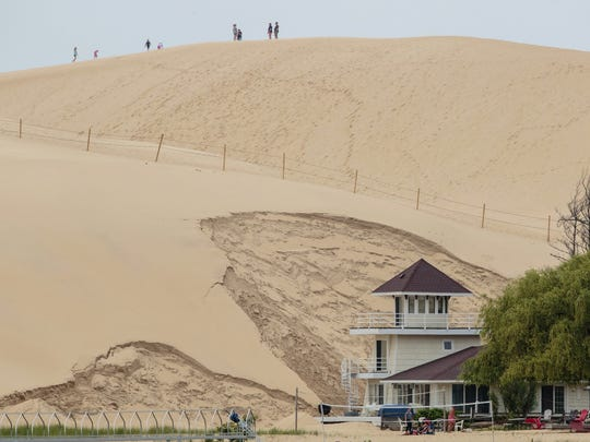 A July 13, 2017, photo shows the approximately 80-foot tall dune that swallowed a cottage in April at the edge of the Silver Lake Lake State Park in Mears, Mich.