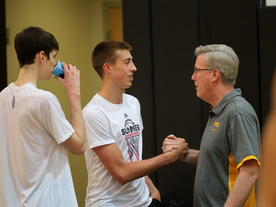 Iowa head coach Fran McCaffery greets Joe Wieskamp