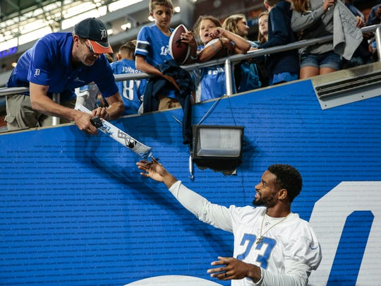 Lions cornerback Darius Slay signs autographs for fans during Family Day at Ford Field, Saturday, August 5, 2017 in Detroit.
