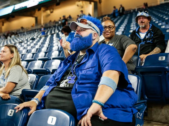 "Lions fan Jason Reid, also known as ""Blue Bear,"" watches Lions practice at Ford Field, Saturday, August 5, 2017 in Detroit."