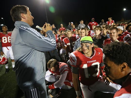 Fishers coach Rick Wimmer, left, talks to the team