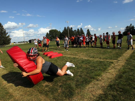 West Branch's Jacob Barnhart runs drills during practice