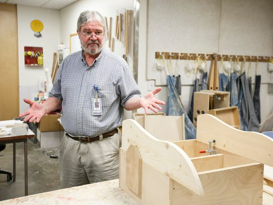 Brian Baker, the supervisor in the Oregon State Hospital woodshop, talks about the benefits the program provides patients on Friday, Aug. 11, 2017. Baker combined his training in occupational therapy with his skills in carpentry to teach and assist the hospital's patients in creating furniture.