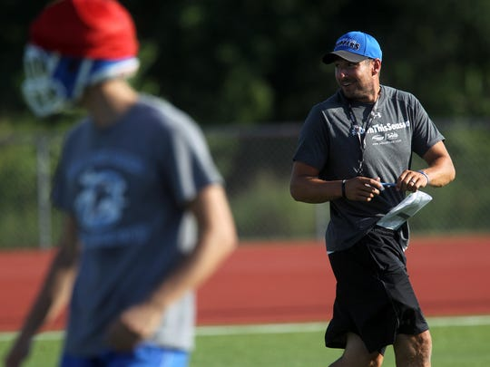 Clear Creek Amana head coach Gabe Bakker watches players during practice on Tuesday, Aug. 8, 2017.