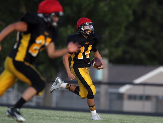 Lone Tree quarterback Harmon Miller runs down field