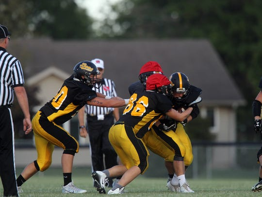 Lone Tree players take part in a scrimmage on Friday, Aug. 11, 2017.