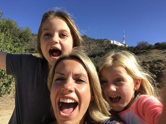 """Millburn's Carly Drum-O'Neill, 40, along with her daughters Taylor, 9, and Keira, 6, right, let out a shout during a trip to Hollywood for the filming of their appearance on the Steve Harvey-hosted show """"Funderdome."""""""