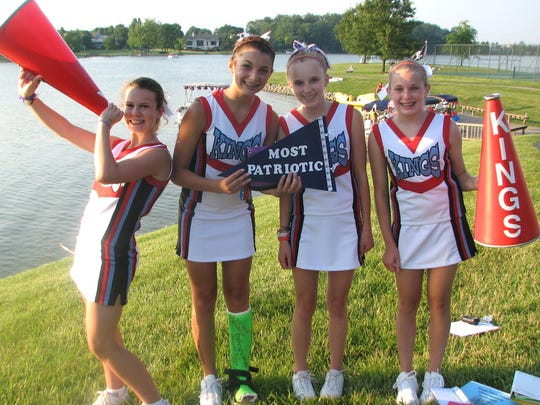 Sabrina Downey, second from left, poses for a picture