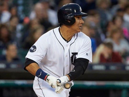 Tigers first baseman Efren Navarro (74) hits a single
