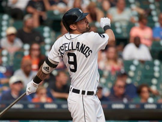 Tigers designated hitter Nick Castellanos (9) hits