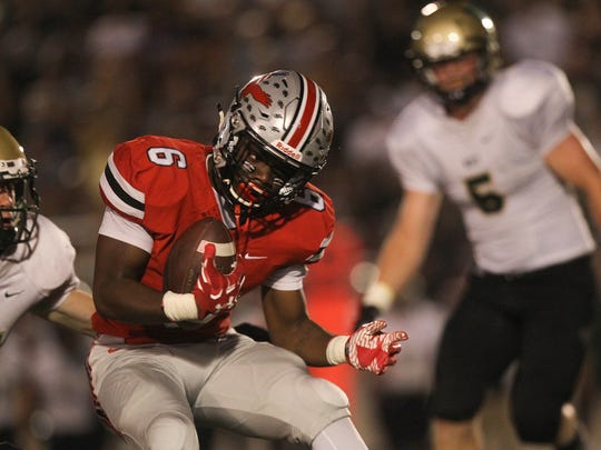 City High's Davonte Foster runs down field during the