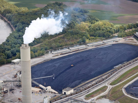 This is Duke's Cayuga Generating Station along the Wabash river, as seen from the air, Thursday, Sept. 7, 2017.  An area full of coal is seen at the right.