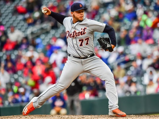 Tigers pitcher Joe Jimenez (77) throws a pitch against the Twins during the seventh inning of the Tigers' 5-1 loss on Sunday, Oct. 1, 2017, in Minneapolis.