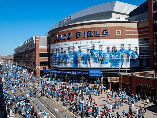 Detroit Lions fans congregate outside of Ford Field in downtown Detroit before the game against the Carolina Panthers on Sunday, Oct. 8, 2017.
