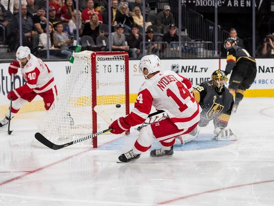 Red Wings right wing Gustav Nyquist (14) scores a goal
