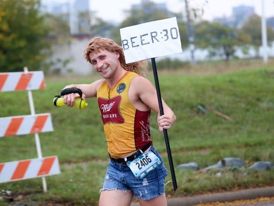Nathan Johnson, 34, of Mesa, Ariz. runs the marathon during the 40th Annual Detroit Free Press/Chemical Bank Marathon in Detroit on Sunday, Oct. 15, 2017.