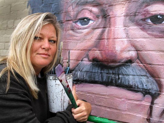 Pamela Bliss poses with her Kurt Vonnegut mural in 2011.