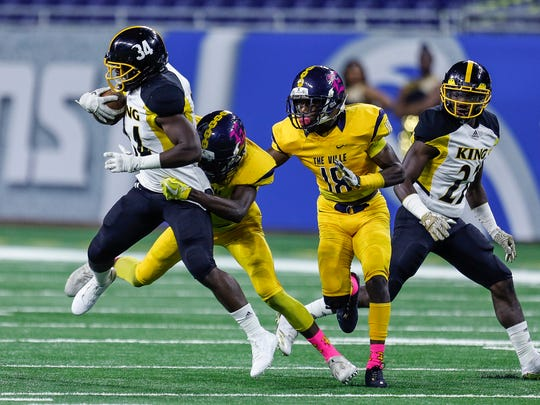 Detroit King's Jalen Jackson is tackled against East English Village during the Detroit Public School League championship game at Ford Field, Oct. 20, 2017.