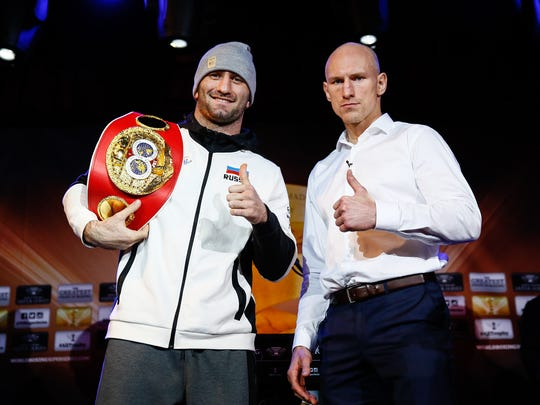 Boxers Murat Gassiev and Krzysztof Wlodarczyk pose for a photo at a news conference Thursday in New York. They meet in the main event Saturday at the Prudential Center in Newark.