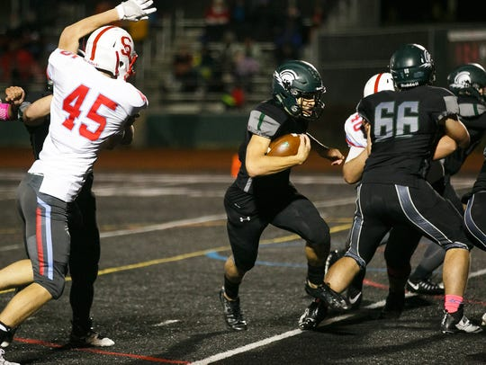West Salem's Simon Thompson (1) carries the ball for