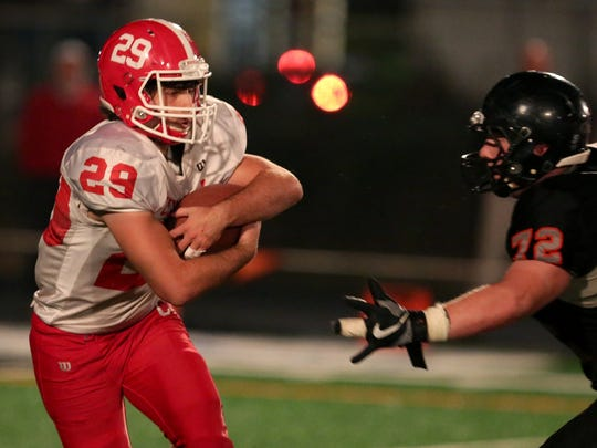 Central's Hunter Chase (29) tries to move past Silverton's Ben Willis (72) in the Central vs. Silverton football game at Silverton High School on Friday, Oct. 20, 2017.