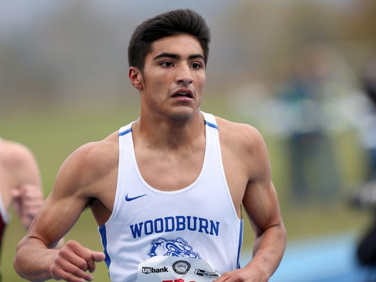 Woodburn's Geovani Bravo, center, competes in the OSAA class 5A State Championship boys cross country meet at Lane Community College in Eugene on Saturday, Nov. 4, 2017.