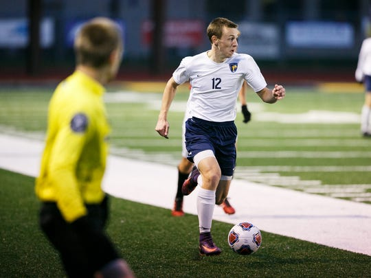 Stayton's Jacobe Croff (12) makes a break for the goal