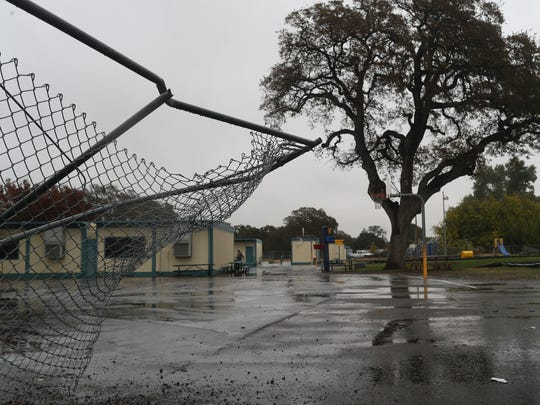 The fence at Rancho Tehama School is bent where shooter