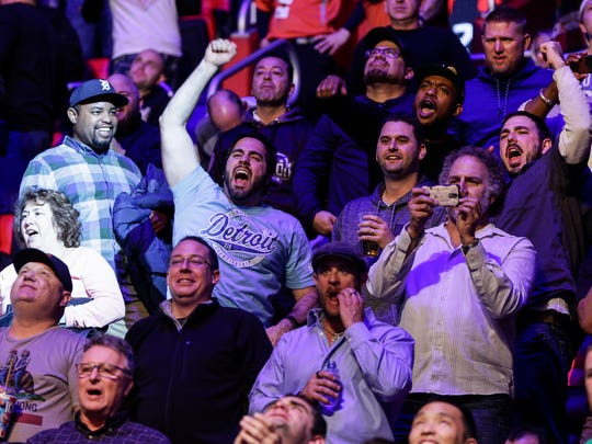 MMA fans cheer during the Eddie Alvarez and Justin Gaethje fight at the UFC 218 at the Little Caesars Arena in Detroit, Saturday, Dec. 2, 2017.