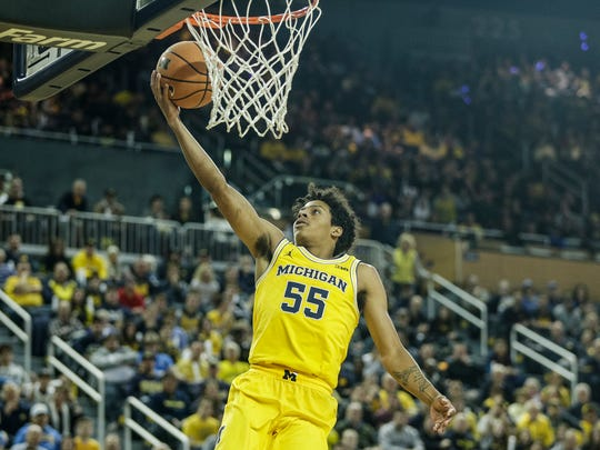 Michigan's Eli Brooks (55) makes a layup against UCLA in the second half at Crisler Center in Ann Arbor, Saturday, Dec. 9, 2017.