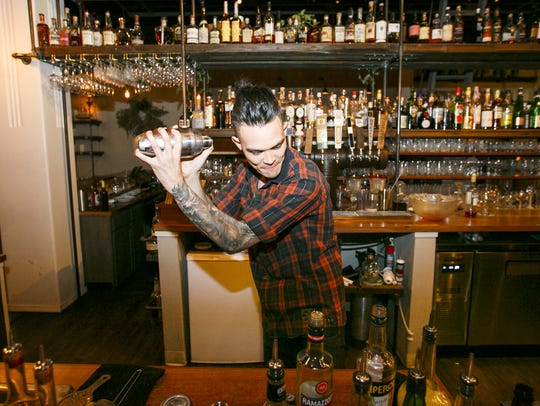 Brent Hayes mixes up a Paper Airplane cocktail at Archive Coffee & Bar in Salem made with bourbon, Aperol and Ramazzotti Amaro. Archive will throw a Valentine's Day bash with drink and dinner specials.