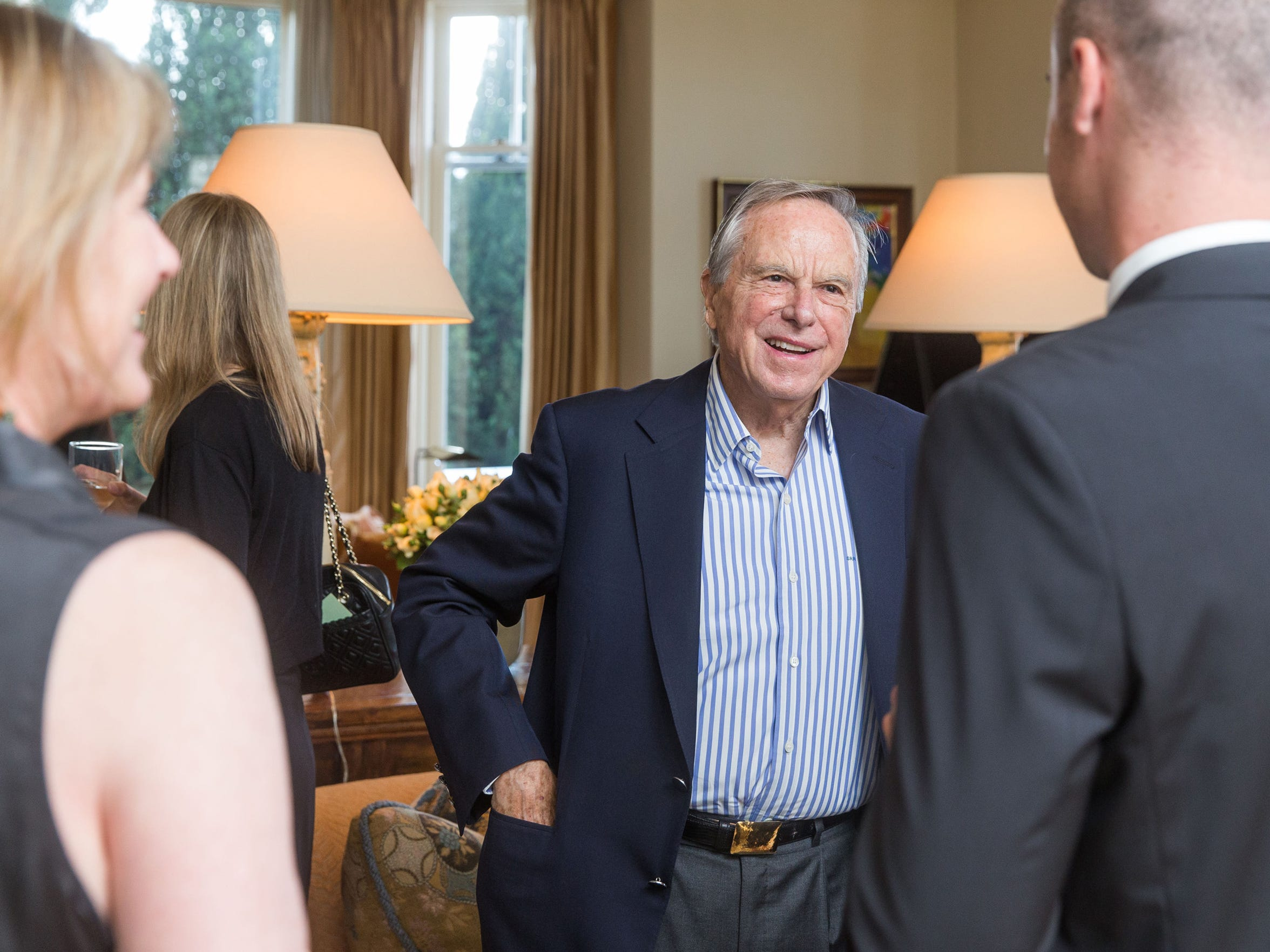 Sandy Robertson greets guests at a reception in his San Francisco home for a private book party celebrating the publication of Inner Spaces, a retrospective of the interior design work of The Wiseman Group in September 2014.