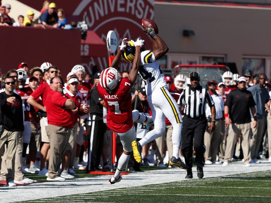 Oct 14; Michigan defensive back Lavert Hill intercepts