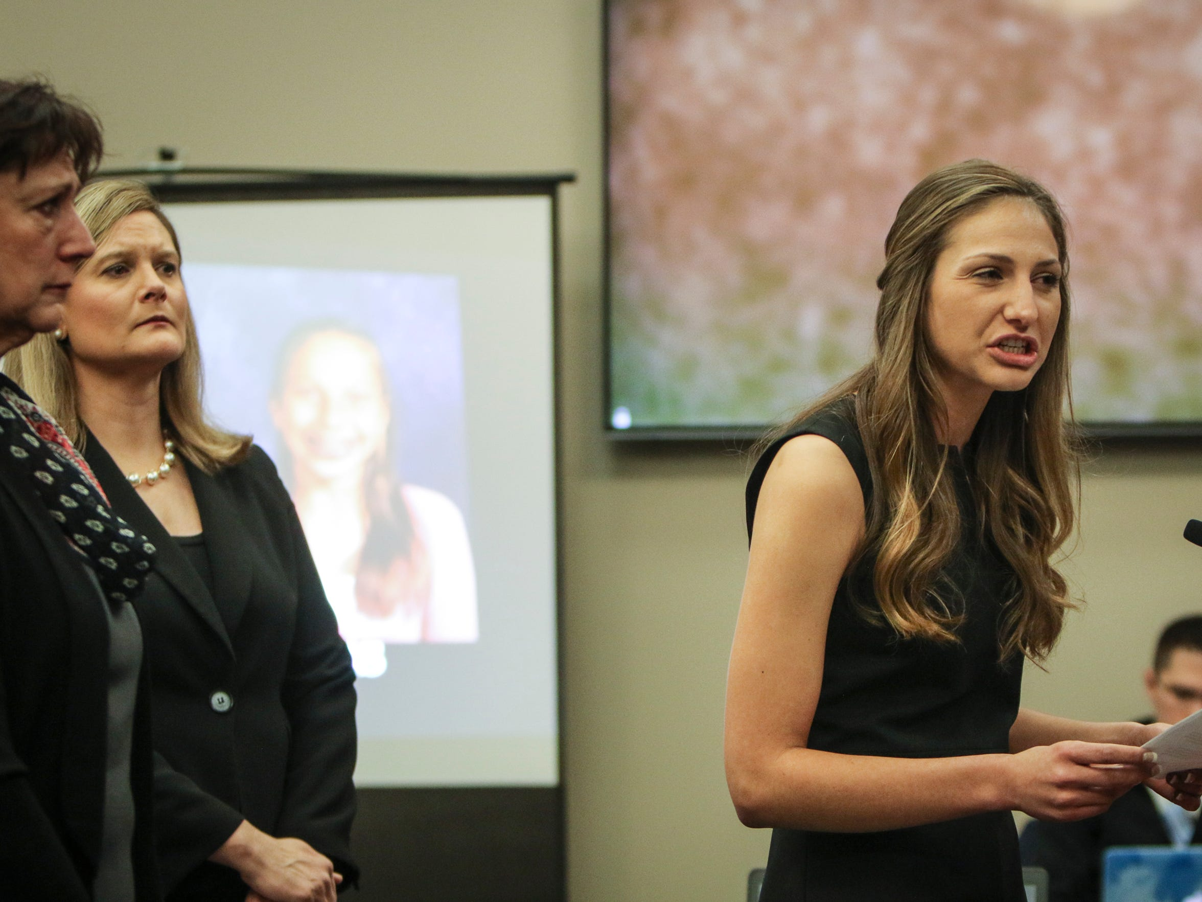 Kyle Stephens, who was abused by Larry Nassar as a child while visiting his home with her family, addresses Larry Nassar on Tuesday, Jan. 16, 2018, the first day of victim-impact statements in his Ingham County sentencing hearing. Behind Stephens at left are her mother and Assistant Attorney General Angela Povilaitis.