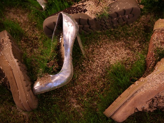 "Grass grows out of shoes in the ""Combat Grass"" installation"